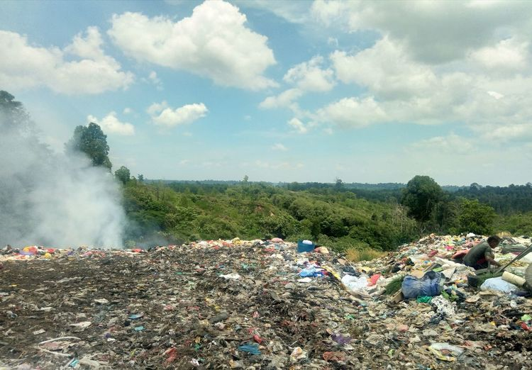 Garbage on land against sky