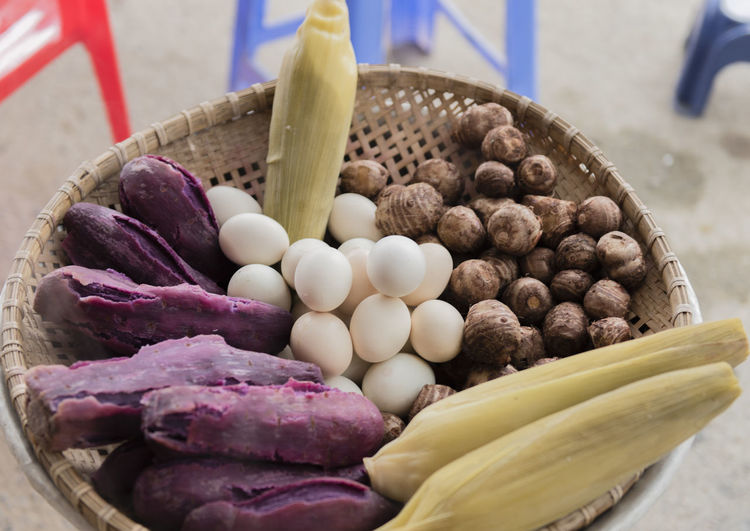 High angle view of eggs and vegetables in wicker basket