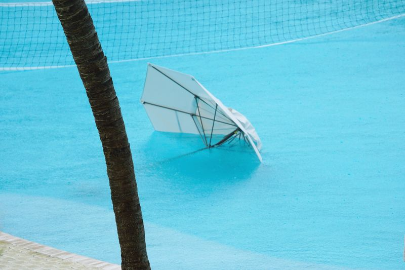 Umbrella in swimming pool