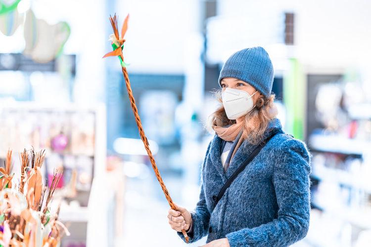 Man holding umbrella standing in winter