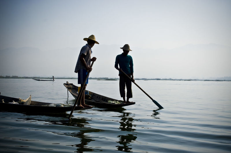 Inde lake fishermen Beauty In Nature Burma Calm Canoeing Check This Out Deep Blue Fisherman Full Length Hanging Out Inle Lake Intha Men Mirror Reflection Mountain Myanmar Nature Ocean Paddling Remote Sea Solitude Tranquil Scene Tranquility Traveling Water