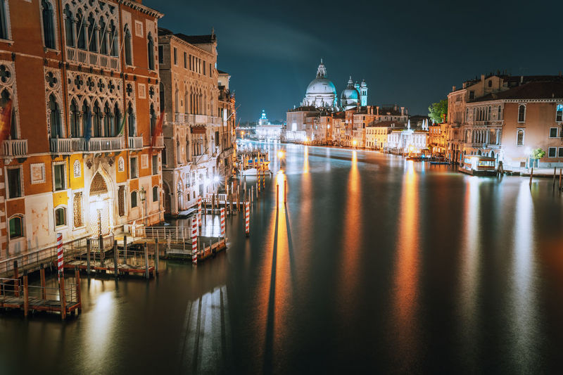 Grand canal amidst illuminated buildings in city at night