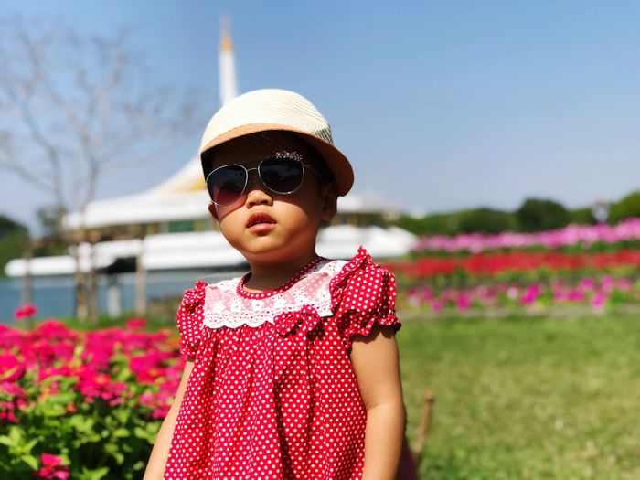 Sunglasses Childhood Focus On Foreground Girls Flower Outdoors Real People Day One Person Front View Standing Sky Lifestyles Child Clear Sky People Nature Leisure Activity EyeEm Ready
