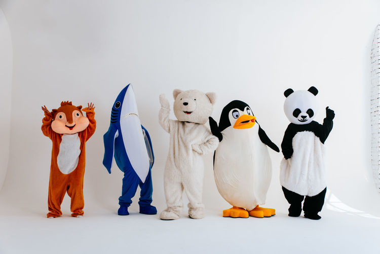 People wearing costume standing over white background