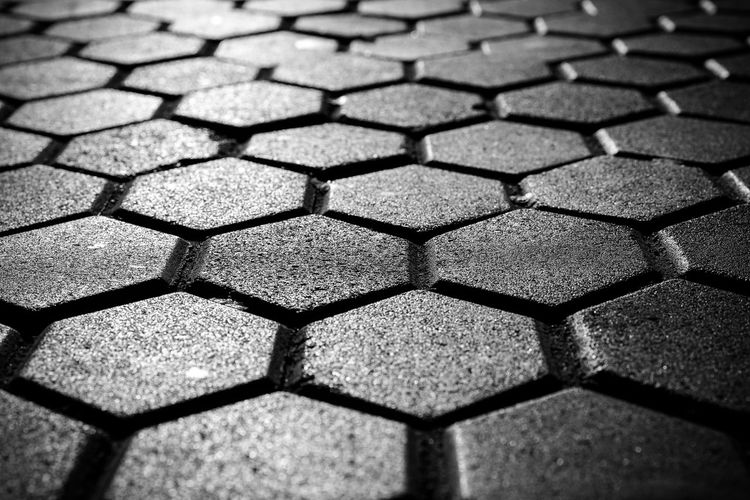 Backgrounds Hexagon Full Frame Pattern No People Close-up Textured  Geometric Shape Shape Design Flooring Day Repetition Street Outdoors High Angle View Footpath Selective Focus Square Shape Focus On Foreground Tiled Floor