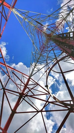 Structure of mobile phone tower Red And White Safety Climbing Feeder Ladders Steel Structure  Cell Phone Tower Mobile Phone Tower Technology Communication Mobile Networks Transmission Self Support Tower Wireless Technology Telecommunications Wireless Network Base Station TelecommunicationTower Metal Structure Sky No People Cloud - Sky Day Cable Low Angle View Outdoors