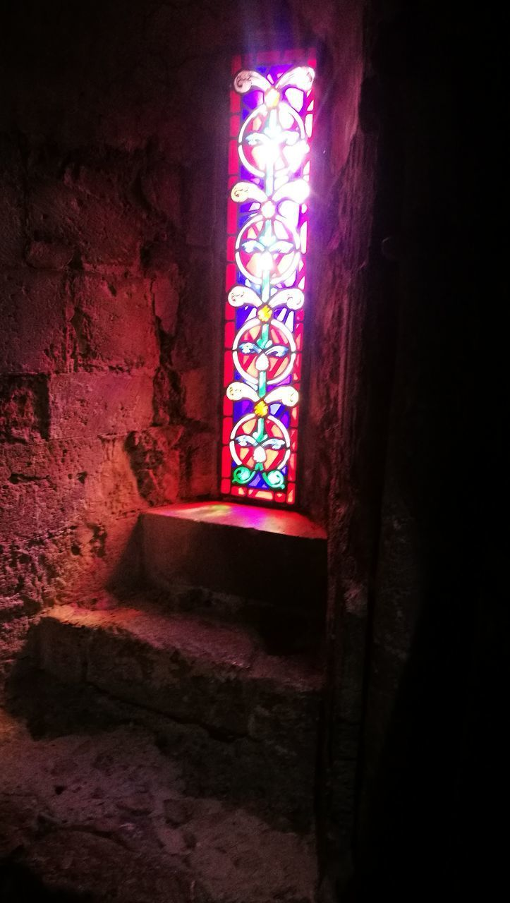 indoors, religion, window, spirituality, no people, multi colored, illuminated, place of worship, low angle view, night