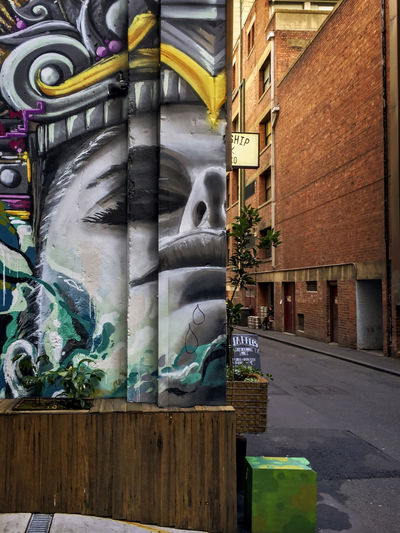 Street Art. Architecture Art And Craft Building Building Exterior Built Structure City Creativity Day Glass - Material Graffiti Human Representation Multi Colored No People Outdoors Representation Sculpture Wall Wall - Building Feature Window Adventures In The City