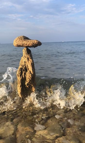 Stone balancing Water Sea Horizon Over Water Rock Sky Solid Rock - Object Tranquil Scene Day Tranquility Land Beach Scenics - Nature Beauty In Nature Horizon Outdoors Wave No People Motion Nature