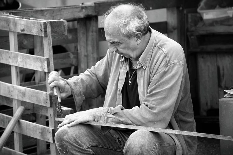 One Person Men Adult Males  Senior Adult Mature Adult Working Real People Three Quarter Length Occupation Mature Men Senior Men Business Industry Sitting Looking Day Concentration Working Activity Carpentry Black And White Photography EyeEmNewHere