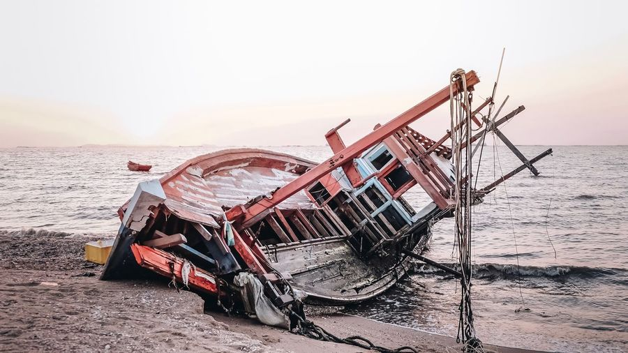 Damage from time Boath Sky Transportation Mode Of Transportation Water Beach Sea My Best Photo Land No People Damaged Outdoors