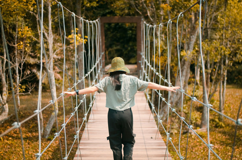 Natural is calling Adult Architecture Bridge Casual Clothing Clothing Day Fence Footbridge Motion Nature One Person Outdoors Plant Railing Real People Rear View Three Quarter Length Tree Young Adult First Eyeem Photo EyeEmNewHere
