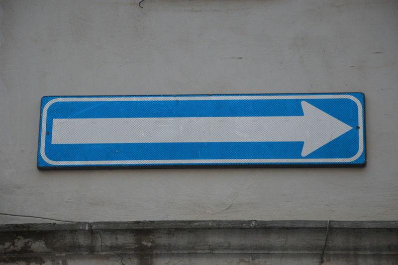 Close-up of arrow symbol on wall