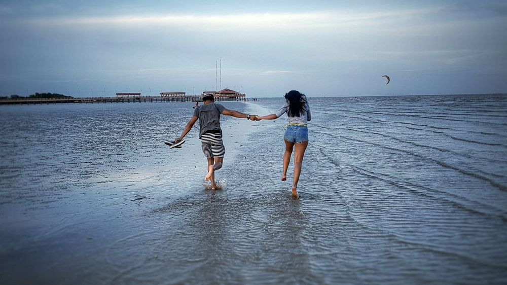 Two People Togetherness Standing Beach Sea Vacations Summer Horizon Over Water People Adult Leisure Activity Bonding Full Length Fun Enjoyment Day Child Sky Young Adult Childhood Love Valentine's Day  Premium Collection Getty Images Bestsellers Live For The Story BYOPaper! The Great Outdoors - 2017 EyeEm Awards EyeEmNewHere Out Of The Box The Great Outdoors - 2017 EyeEm Awards Place Of Heart Sommergefühle EyeEm Selects 100 Days Of Summer Breathing Space Mix Yourself A Good Time Done That. The Week On EyeEm Lost In The Landscape Connected By Travel Second Acts Perspectives On Nature Be. Ready. Go Higher Summer Exploratorium