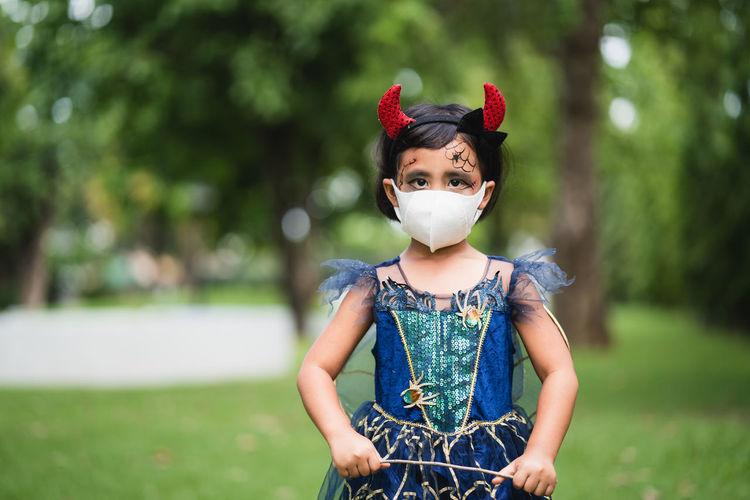 Portrait of cute girl in halloween costume.