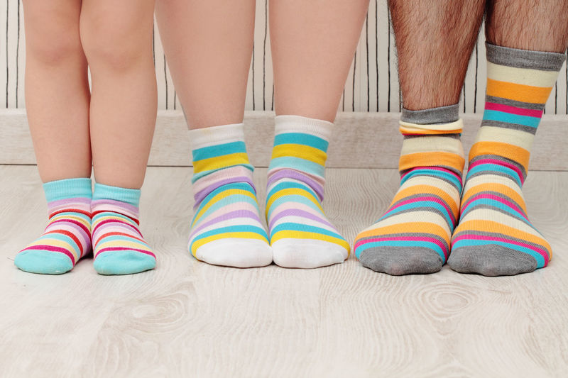 Family in striped socks Adult Family Friendship Human Body Part Human Leg Low Section Multi Colored Pattern People Togetherness Young Adult