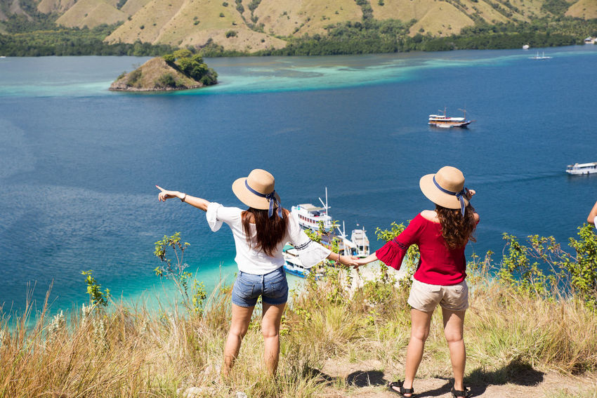 The Red and White Two People Togetherness Water Sea Vacations High Angle View Nature Outdoors Adult Standing Beach Leisure Activity Women Kelor Island Komodo National Park Flores