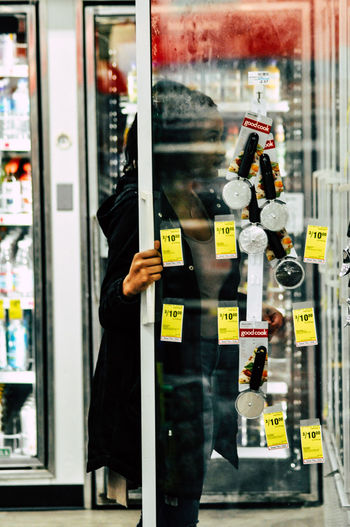 Man standing by window at store