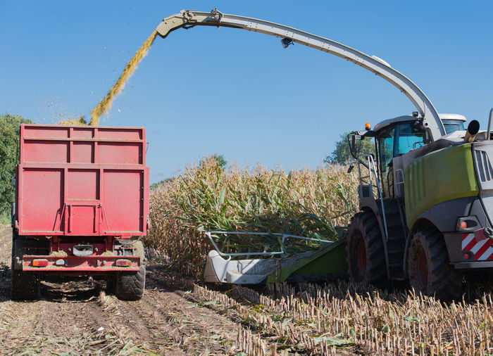 Agricultural Machinery Spraying Grains At Farm