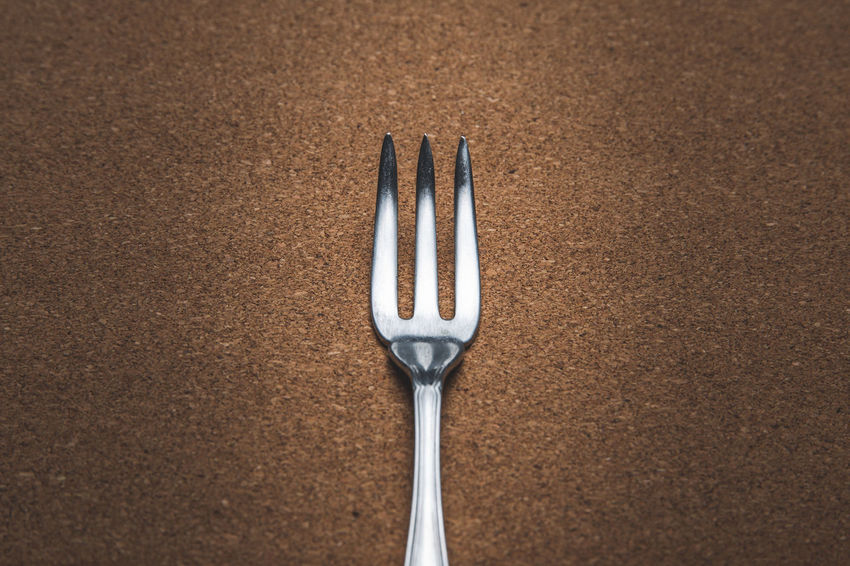 Close up view of a shiny fork Alloy Close-up Directly Above Eating Utensil Food Food And Drink Fork Freshness High Angle View Household Equipment Indoors  Kitchen Utensil Metal No People Silver - Metal Silver Colored Spoon Steel Still Life Studio Shot Table Table Knife