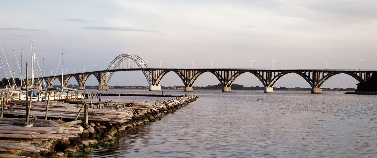 Harbour with Bridge to the island of Møn in the background Baltic Sea Denmark Falster Panorama Panoramic View Travel Photography Arch Architecture Bridge Bridge - Man Made Structure Built Structure Connection Connections Engineering Europe Island Monochrome Nature No People Outdoors River Sky Transportation Travel Destinations Zealand
