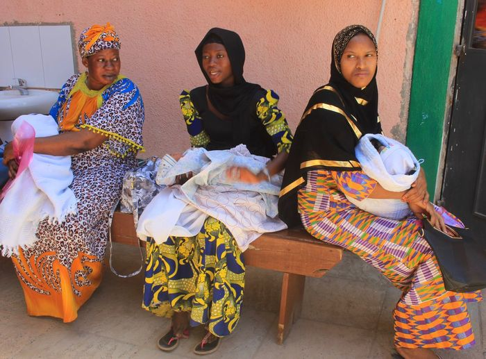 Gambian women at the maternity clinic Babies Vlisco Maternity Clinic Bundung Gambia  Hospital African Mother And Child African Beauty Mothers Sitting Sari Women Young Women