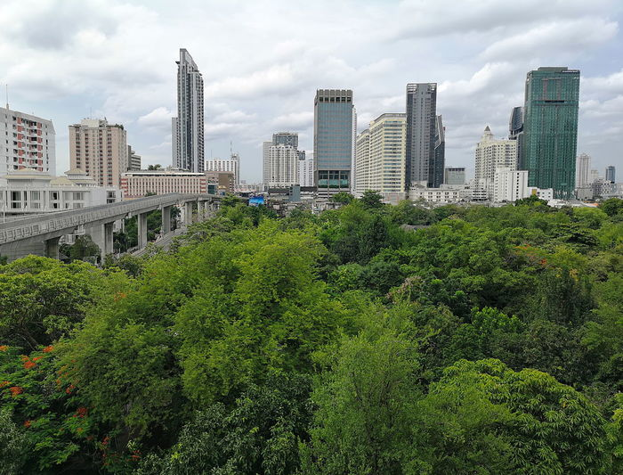 BTS Rail Way Bangkok Architecture Big Trees Building Built Structure City Cityscape Cloud - Sky Green Color Green In The City Greenery Hrd Landscape Mobile Photography Outdoors Plant Sky Skyscraper Tree