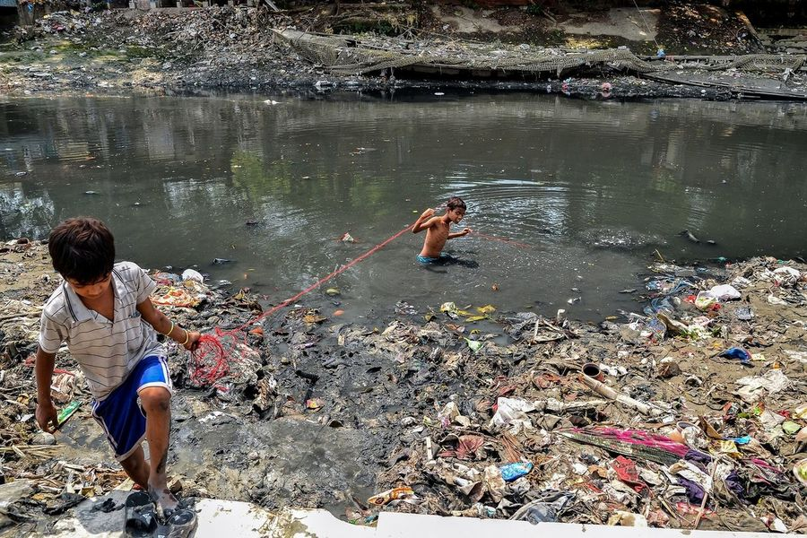 Pulling out Garbage - A boy half submerged in one of the most polluted rivers in the city. Adi Ganga, the nearly 75 km long original channel of national river Ganga, has been hijacked at several places. Years of so called modernisation has polluted the river with plastic, debris, cultural offferings and other what nots. Many a times plastic materials have been found floating on the canal bed. Finally the municipality has imposed heavy penalty on anyone found polluting the river. 2018 Calcutta Debarshi Mukherjee Photography Documentary Photography Environmental Pollution India Kolkata Planetorplastic River Pollution UN Environmen Beatplasticpollution Debarshimukherjee Environment Garbage People Pollution Real People River Savetheplanet World Environment Day Plastic Environment - LIMEX IMAGINE The Street Photographer - 2018 EyeEm Awards The Photojournalist - 2018 EyeEm Awards EyeEmNewHere