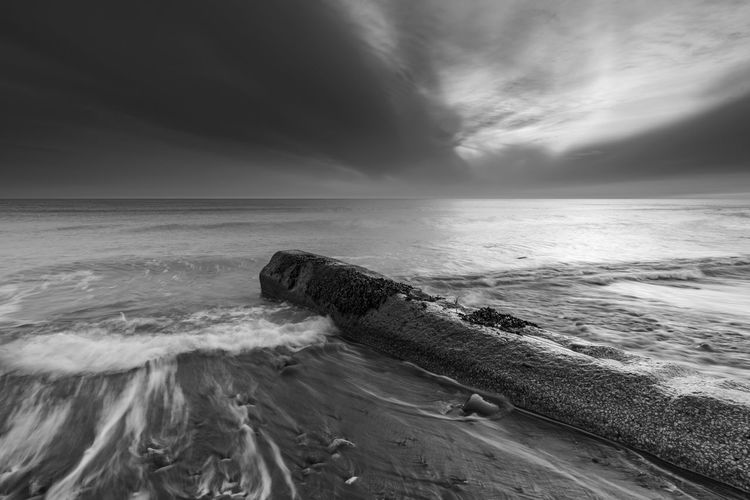 Mono West Cumbrian coast Alone Cloud Cumbria Industry Pipeline Rock Rugged Weather Black And White Environment Horizon Over Water Mono Moody No People Pipe Into Sea Sand Sea Sea Pollution Seascape Shore Tide Water Waves