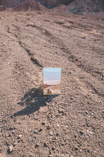 Arid Climate Beauty In Nature Brown Climate Day Dirt High Angle View Land Landscape Mirror Reflection Mountain Nature No People Outdoors Remote Rock Rock - Object Sand Scenics - Nature Solid Sunlight Tranquil Scene Tranquility Visual Creativity