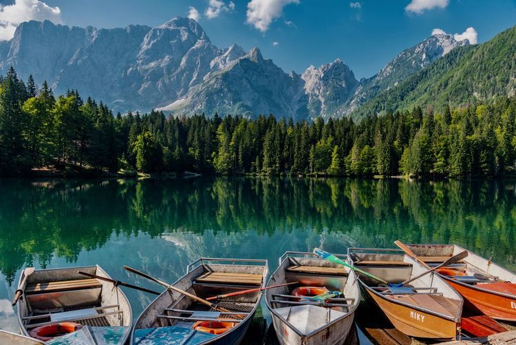 Panoramic view of boats moored in lake against mountains