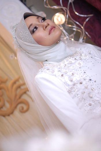 Bride looking away during wedding ceremony