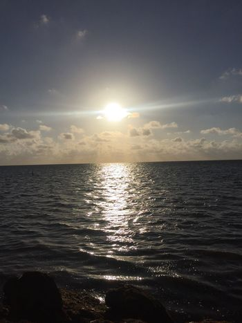 Sea Water Tranquility Scenics Tranquil Scene Sun Beauty In Nature Nature Horizon Over Water Idyllic Sky Sunbeam Beach Sunlight Sunset Reflection Outdoors Rippled No People Day