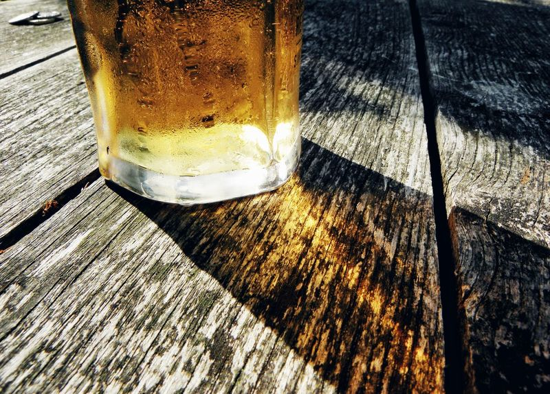 Table Drink Refreshment Drinking Glass No People Food And Drink Close-up Day Alcohol Wood - Material Shadow Indoors  Freshness Shade Sun Weekend Party Hot Weather Summer Ready To Drink Drinking Beer Thirsty  Thirst