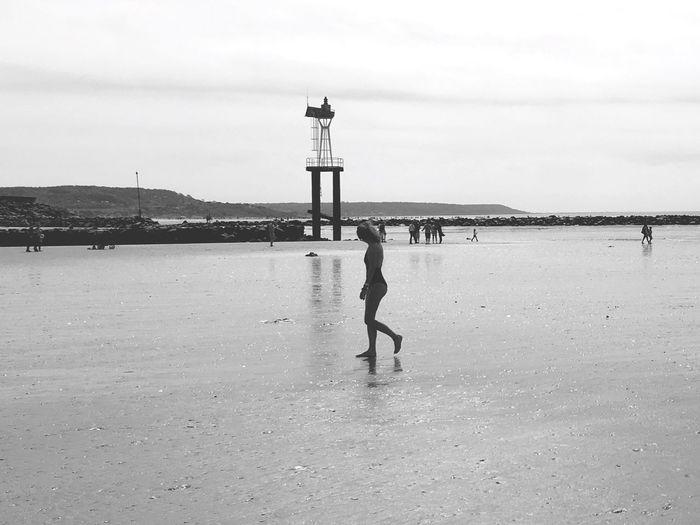 Woman Walking On Sand At Beach