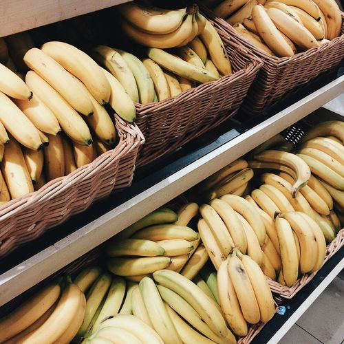 Bananas in baskets for sale at market