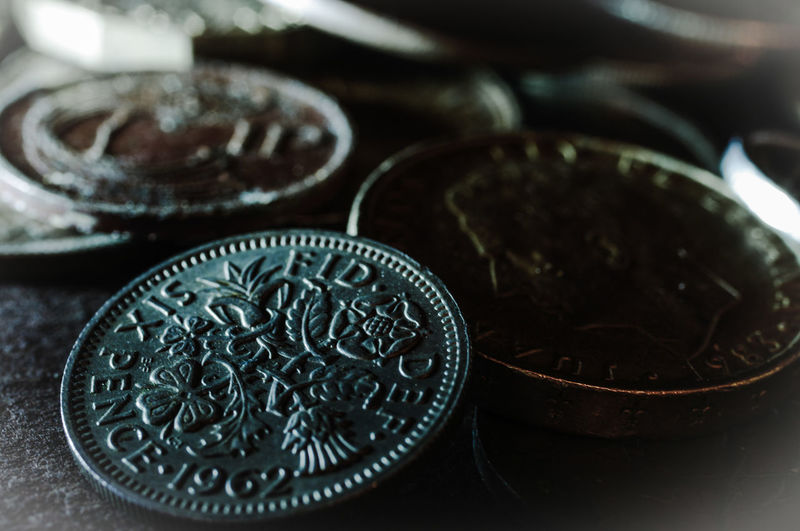 Close-Up Of Old Coins On Table