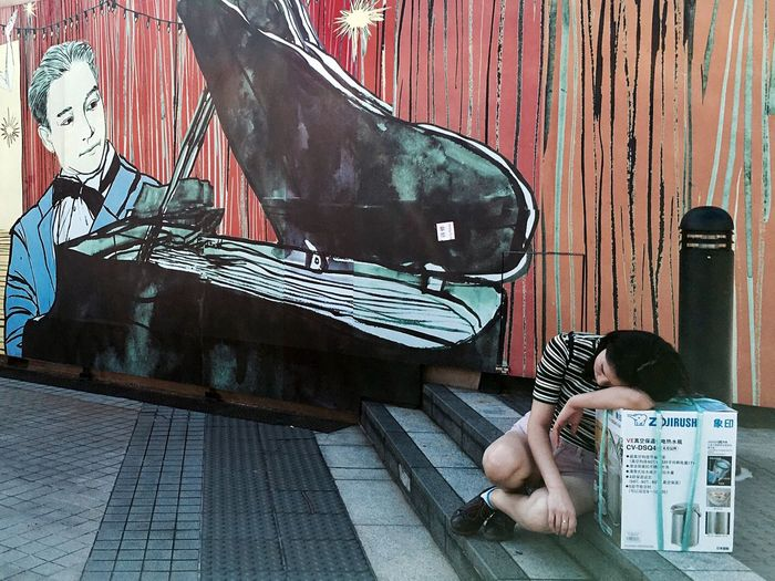Two People Piano Picture On Wall Woman Sleeping Taking A Break Urban Lifestyle City Life Street Photography IPhoneography Cityscape Pattern, Texture, Shape And Form People Watching Light And Shadow Outdoors Snap A Stranger