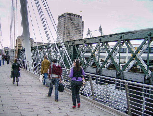 Adult Bridge - Man Made Structure Built Structure City Connection England Full Length Gran Bretagna Great Britain Großbritannien Inghilterra Leisure Activity Outdoors People Riding Skyscraper Suspension Bridge Togetherness Tourism Transportation Travel Walking Women Young Adult Young Women