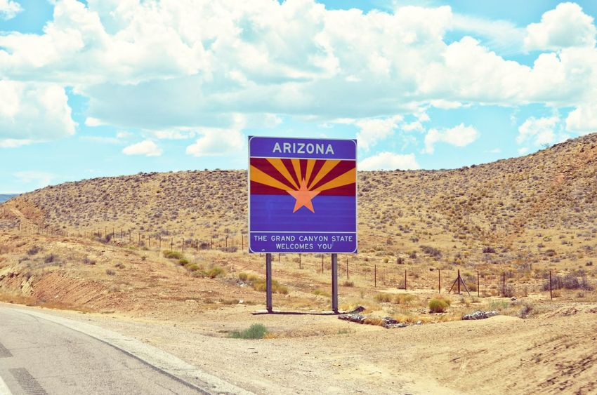 Welcome to Arizona Arizona Arizona Sky Border Summer Road Tripping Road Sign Desert Rural Scene Sand Communication Text Road Business Finance And Industry Sky Cloud - Sky Arrow Sign