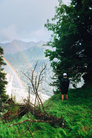 Catching the double rainbow pre-heavy rain danger hike. Colors Exploring EyeEm EyeEm Best Shots Nature Adventure Beauty In Nature Day Explore Forest Full Length Growth Land Mountain Mountain Range Nature One Person Rainbow Real People Scenics - Nature Sky Tranquil Scene Tranquility Travel Destinations Tree