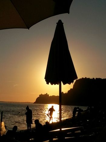 Colour Of Life Sunset Silhouettes Summer 2016 Sunset_collection Colors Of The Night Beach Umbrella Beach Sunset Castello Di Duino Beach Silhouettes Sunset At The Beach Live For The Story