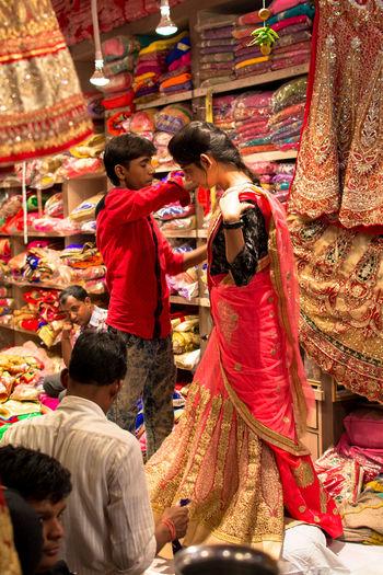 Bride Wedding Dress Jaipur Market Shop Try On Beautiful Girl India Saree Fashion Saree Wedding Saree Traditional Culture Traditional Clothing Fashion Fashion&love&beauty Street Photography Street Fashion Fashionstyle Colorful Colors Fabrics The Portraitist - 2017 EyeEm Awards The Photojournalist - 2017 EyeEm Awards