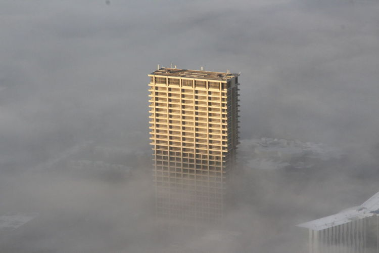 A building is covered in fog in Chicago Chicago Chicago Architecture Building Exterior Built Structure Architecture Building Cloud - Sky No People Sky Skyscraper City Tall - High Day Modern Tower Office Outdoors Low Angle View Fog Foggy Urban Skyline Urban Architecture City Cityscape
