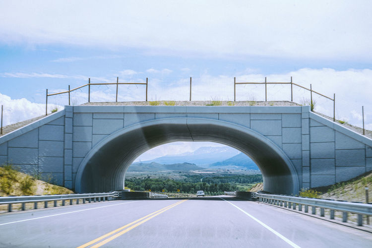 Bridge over road against sky