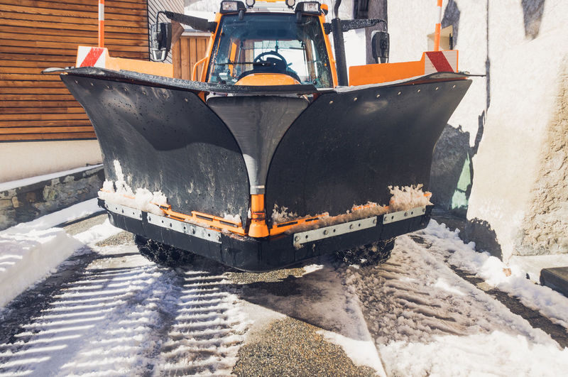 High angle view of snowplow in city during winter