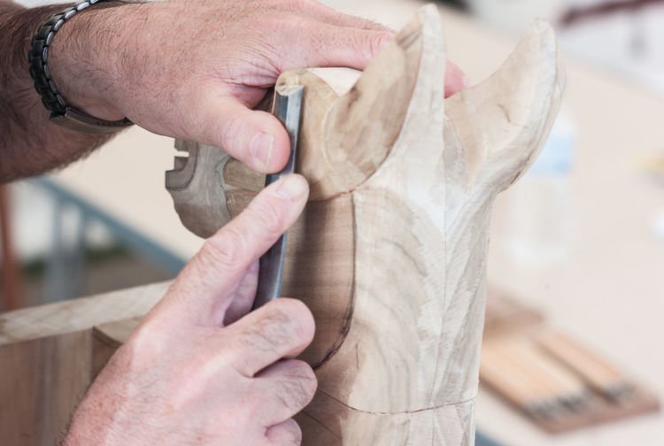 Cropped Hands Of Man Carving Wood