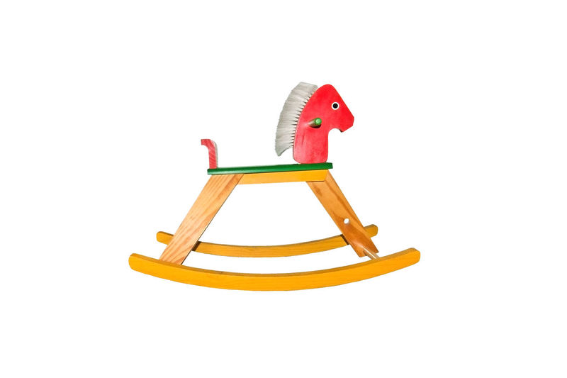 Toy rocking horse painted in bright red and green colors isolated on white. Isolated Cut Out Cut Out On White Model - Object No People Red Rocking Horse Toy White Background
