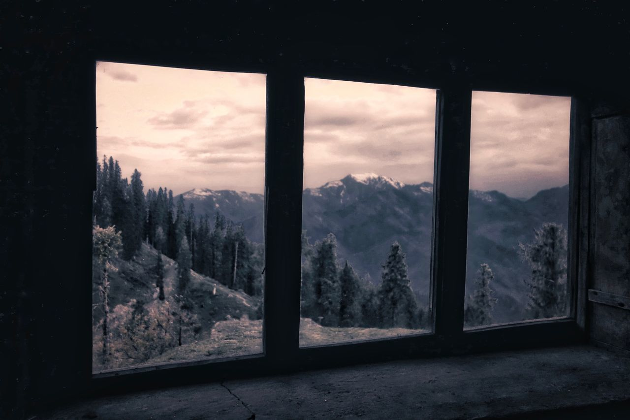 tree, window, sky, indoors, nature, mountain, no people, landscape, cloud - sky, beauty in nature, scenics, day