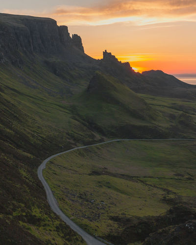 Quiraing, Isle of Skye Rolling Landscape Road Plant Remote Outdoors Cloud - Sky Land No People Nature Idyllic Green Color Mountain Non-urban Scene Sunset Tranquility Tranquil Scene Landscape Scenics - Nature Sky Environment Beauty In Nature My Best Photo